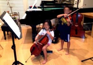 1/10 cello, 1/4 violin full size cello in the background